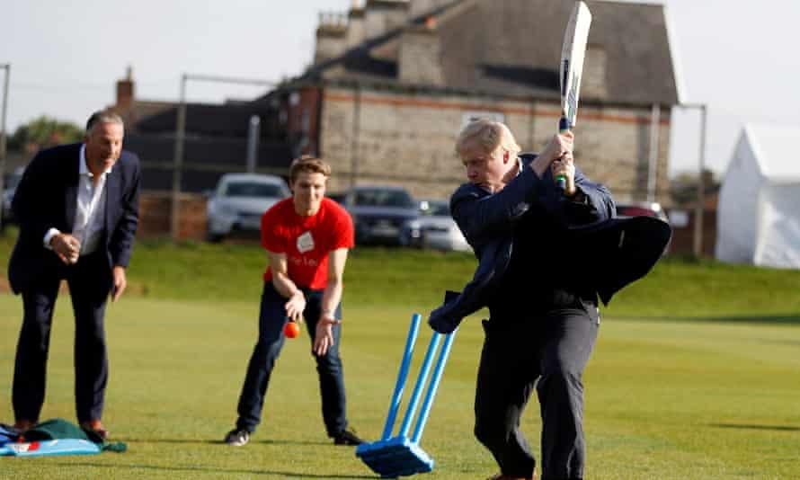 Boris Johnson playing cricket