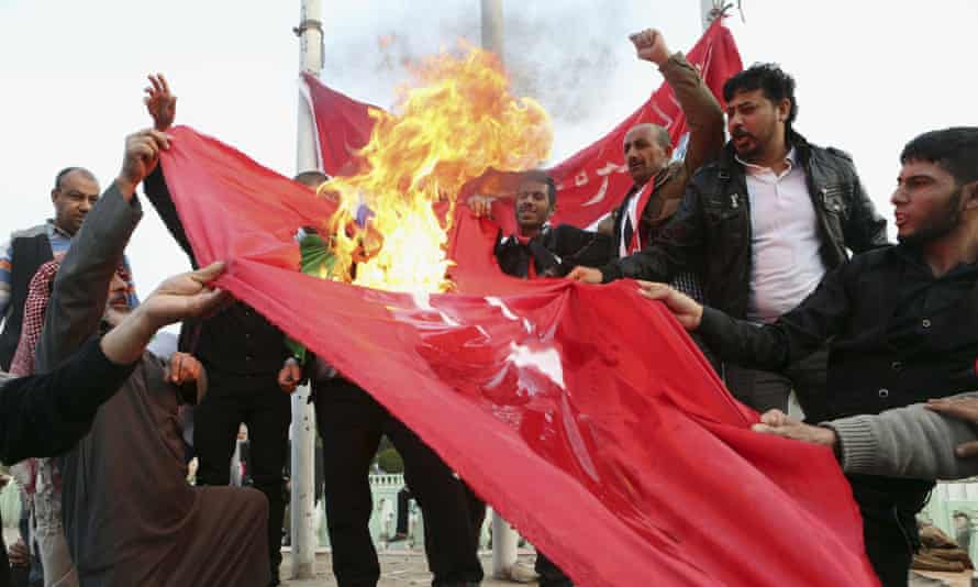 Protesters burn a Turkish flag during a demonstration calling for the withdrawal of Turkish troops from northern Iraq.