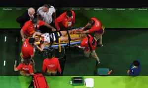 France's Samir Ait Said is stretchered away after fracturing his lower leg in a crash landing from the vault.