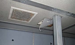 A shower unit with protruding electric cable at HMP Liverpool.