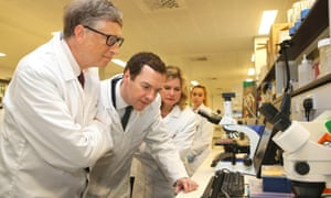 Bill Gates and George Osborne tour a research lab at the Liverpool School of Tropical Medicine.