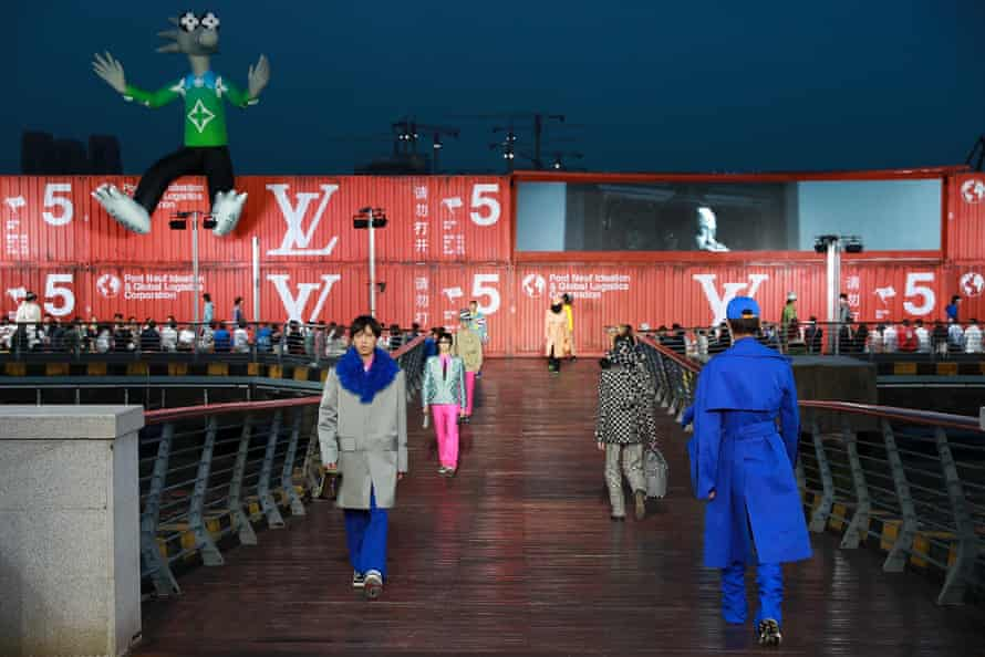 Models walk the runway during the Louis Vuitton spring//summer 2021 men's collection in Shanghai