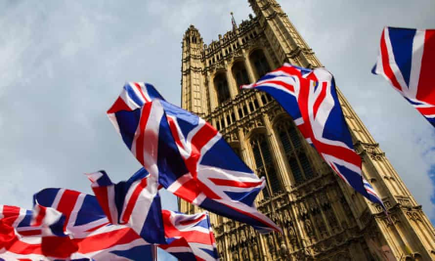 Union Jack flags outside the Houses of Parliament.