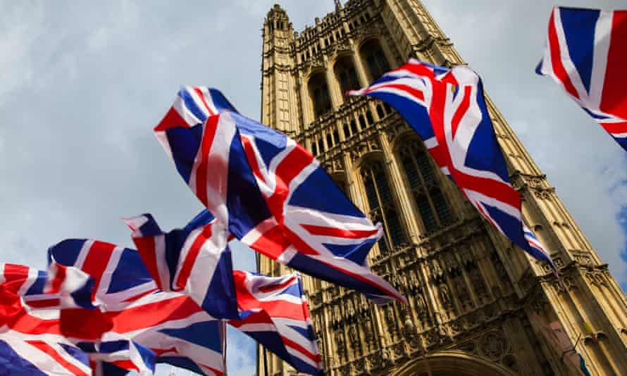 Union flags fluttering outside the Houses of Parliament.