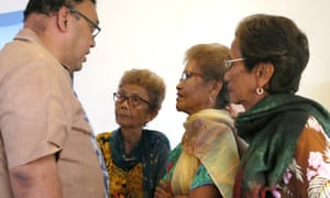 Harry Roque, lawyer, confers with three of the Filipino wartime sex slaves
