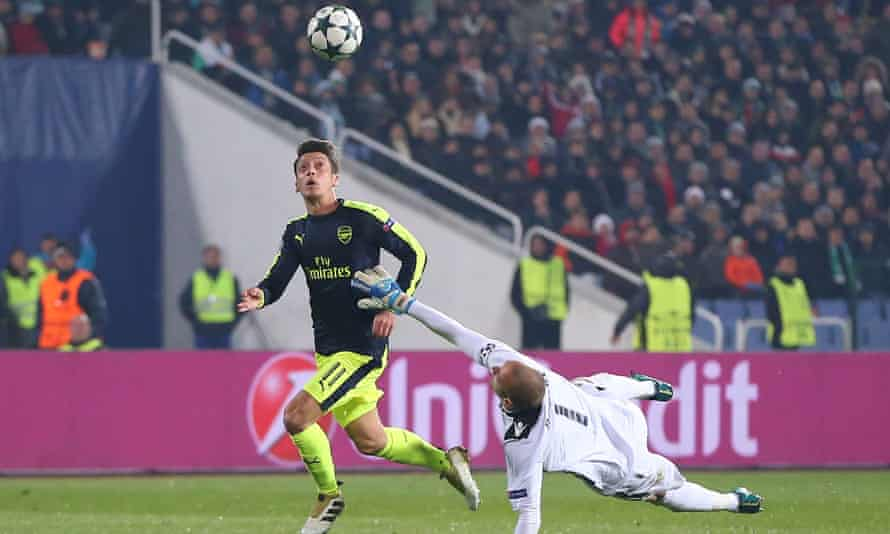 Mesut Özil lobs the ball over the Ludogorets keeper for his masterpiece winner in Arsenal's 3-2 Champions League victory.