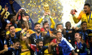 France's Hugo Lloris lifts the World Cup trophy as they celebrate winning.