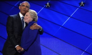TOPSHOT - US President Barack Obama (L) hugs US Presidential nominee Hillary Clinton during the third night of the Democratic National Convention at the Wells Fargo Center in Philadelphia, Pennsylvania, July 27, 2016. / AFP PHOTO / Robyn BECKROBYN BECK/AFP/Getty Images