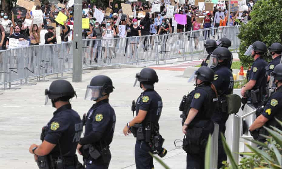 Orlando Police line up in front of the OPD headquarters on South Street as protesters arrive to demonstrate in Orlando, Florida.
