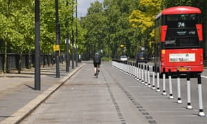 A cyclist using a pop-up cycle lane in Park Lane, London, this morning.
