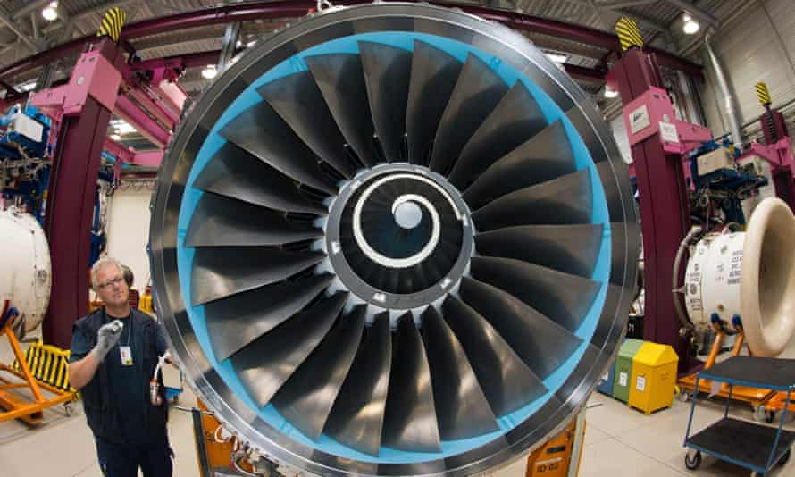 A Rolls-Royce mechanic working on a plane engine in the factory in Dahlewitz, Germany