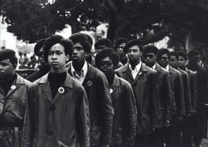 Panthers march at Defermery Path in Oakland during a rally to free Huey, 1969