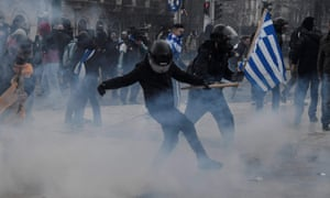 Protesters clash with police in front of the Greek parliament in Athens.