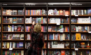 A customer reaches for a book in a branch of Waterstones