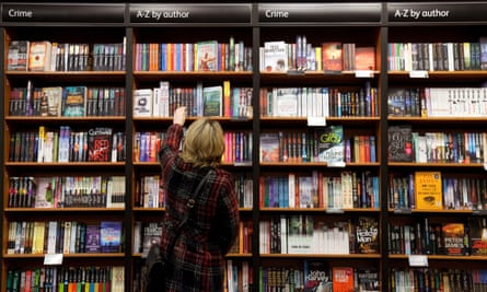 Woman buying crime fiction books, Waterstones bookshop, Cambridge UK