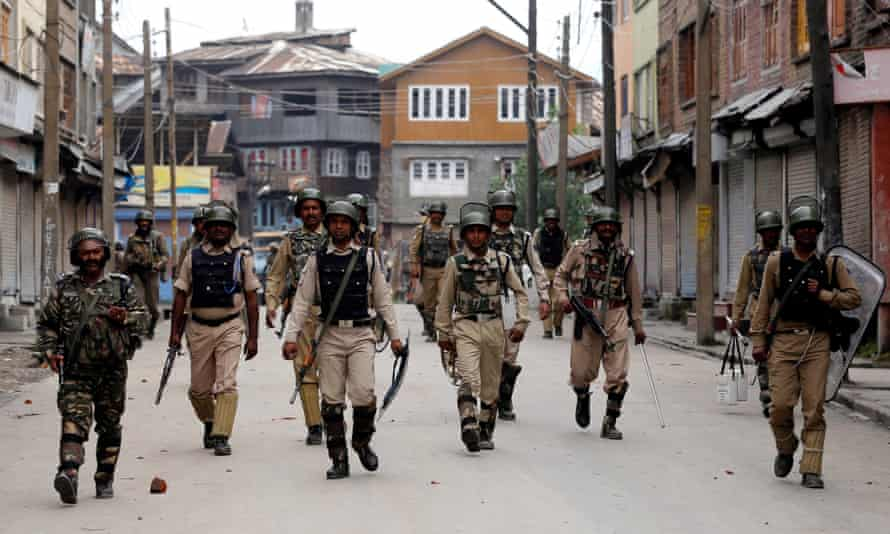 Indian paramilitary soldiers patrol the Batamaloo area of Srinagar, the summer capital of Indian Kashmir. Police and paramilitary presence has intensified since clashes broke out in the valley region in July.