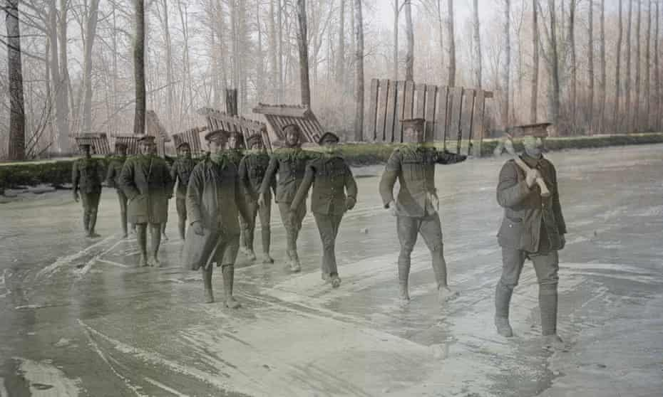 Members of the Royal Garrison Artillery carry duck-boards across the frozen Somme at Frise, France.
