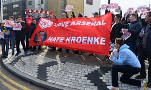 Arsenal fans display a message for Kroenke prior to a Premier League match against Norwich in 2016.