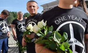 "People wear T-shirts stating: ""MH17 one year in the skies"" outside the Dutch embassy in Kiev, on the first anniversary of the crash."