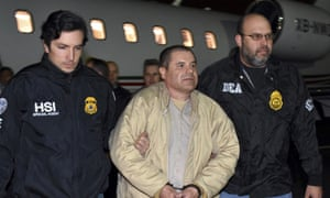 Law enforcement authorities escort Joaquin 'El Chapo' Guzman in New York in 2017. Jury selection has begun under tight security at the New York trial of the Mexican cartel boss.