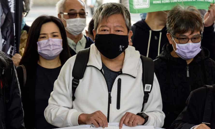 Hong Kong pro-democracy activist Lee Cheuk-yan (centre) arrives at the court in Hong Kong on Tuesday.