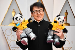 Actor Jackie Chan with some pandas
