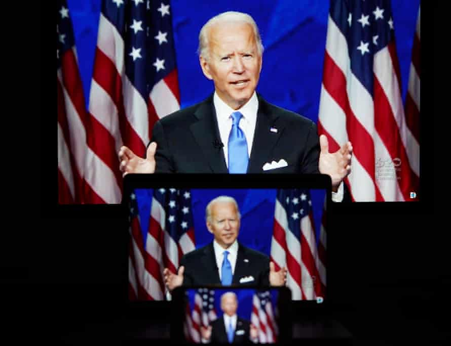 Screens displaying images of Joe Biden speaking in a video feed at the Democratic national convention on Thursday.