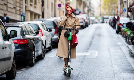 A rider on the streets of Paris where e-scooters are a popular form of transport.