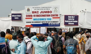 People queue outside a vaccine centre in Mumbai.