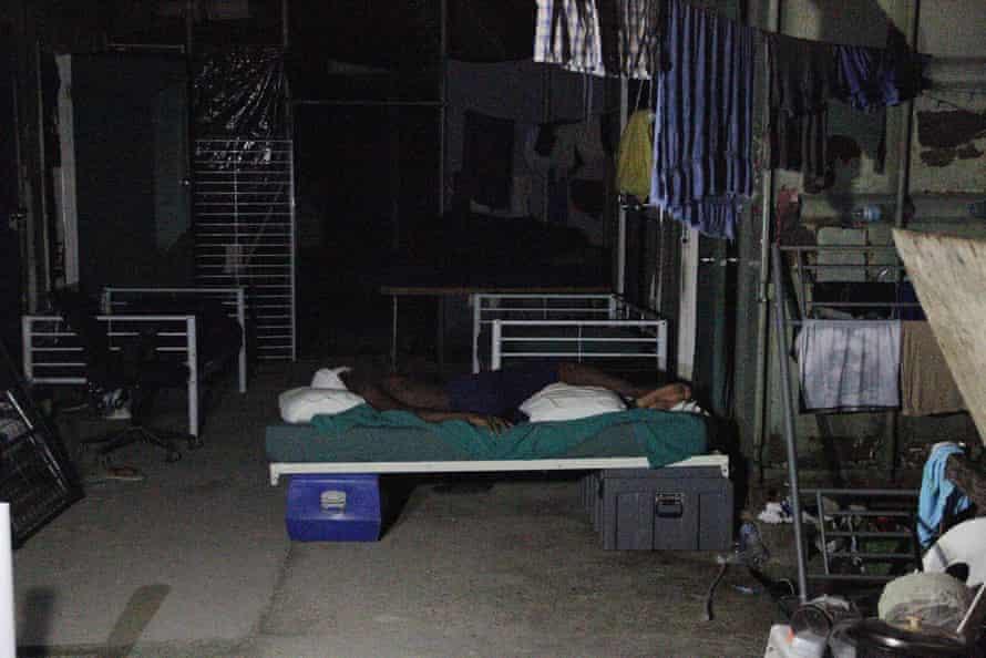 A refugee sleeps inside the Manus Island detention centre