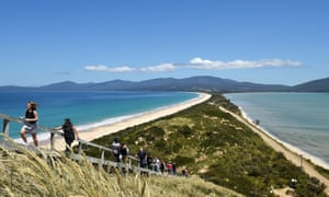Tourists walk to a lookout at The Neck on Bruny Island in Tasmania.