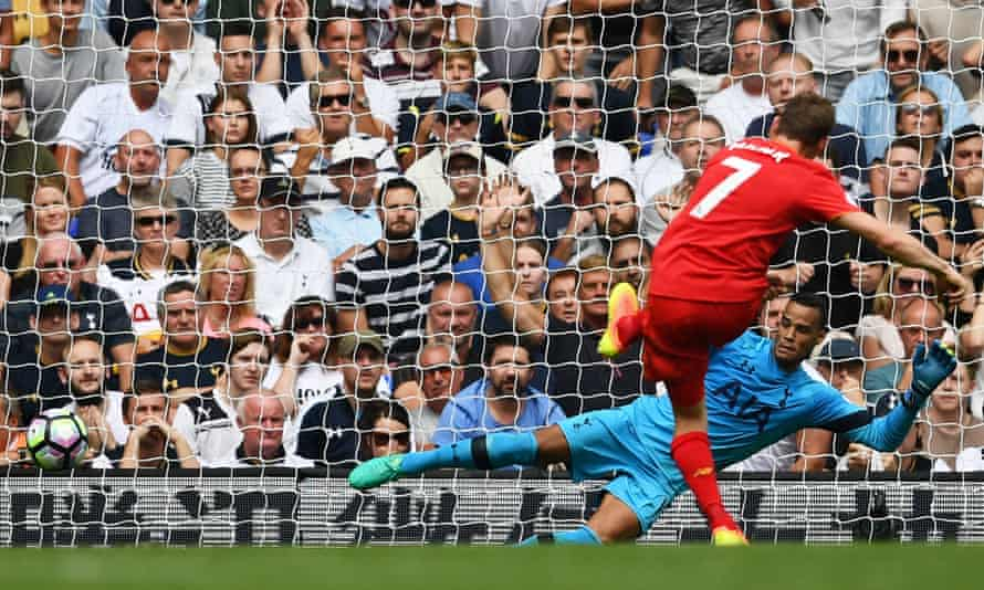 James Milner sends Michel Vorm the wrong way to open the scoring from the penalty spot.