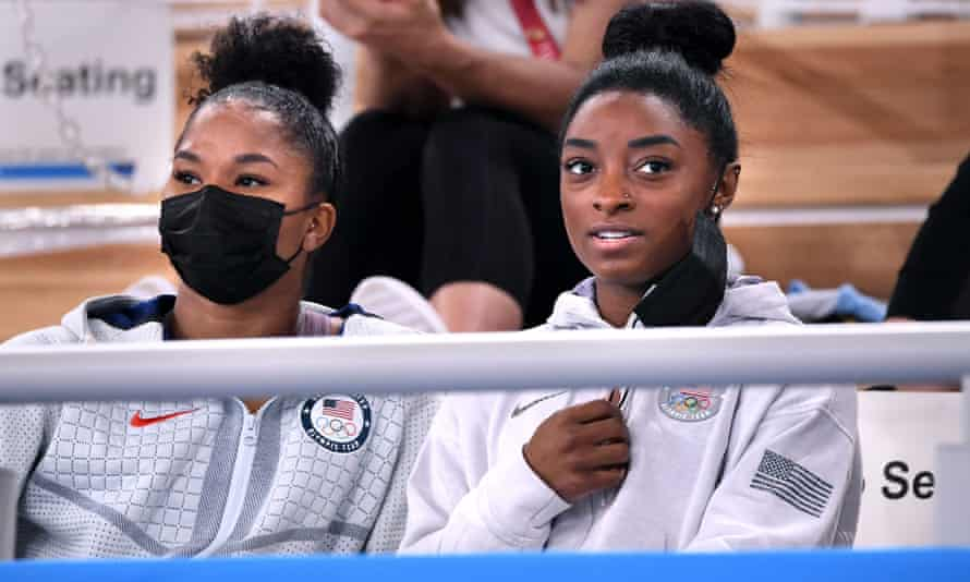 Simone Biles, right and Jordan Chiles watch the women's individual all-around final