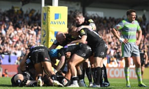 Exeter Chiefs players celebrate with Don Armand after his try in the semi-final victory over Newcastle.