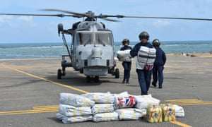 A Royal Navy ground crew unloads disaster supplies from a Wildcat helicopter in the British Virgin Islands following Hurricane Irma
