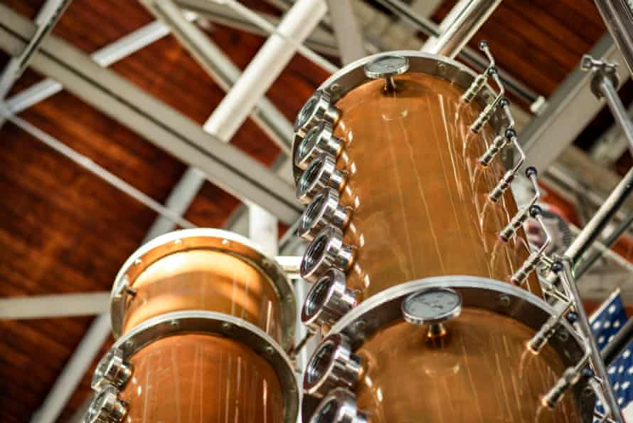 Copper distillery equipment stretches toward the ceiling at Hangar 1.