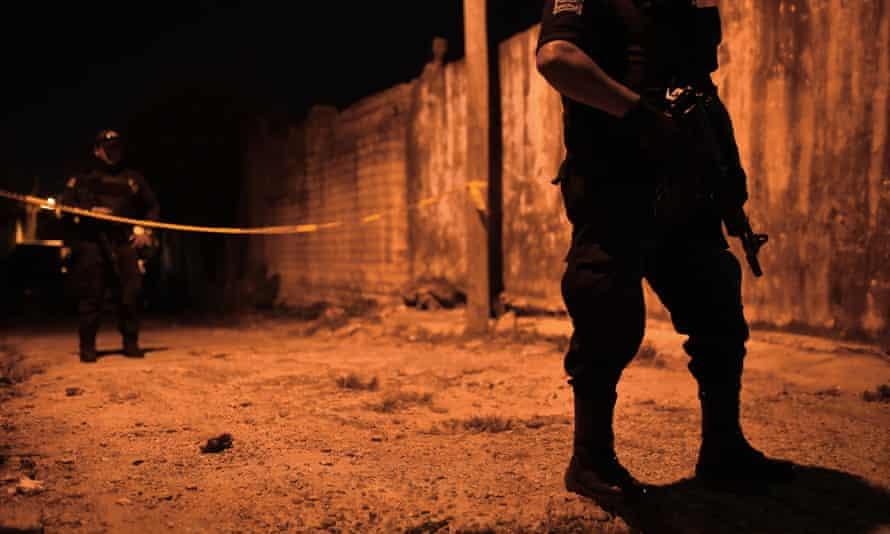 Police guard a crime scene in Veracruz state, the setting for Hurricane Season