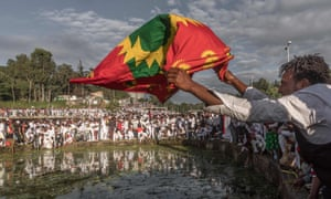 A man waves an Oromo flag