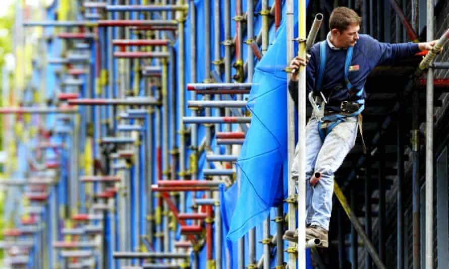 A worker on scaffolding in London