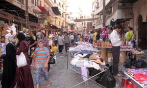 Traders, shops and stalls in the medieval souk in Aleppo