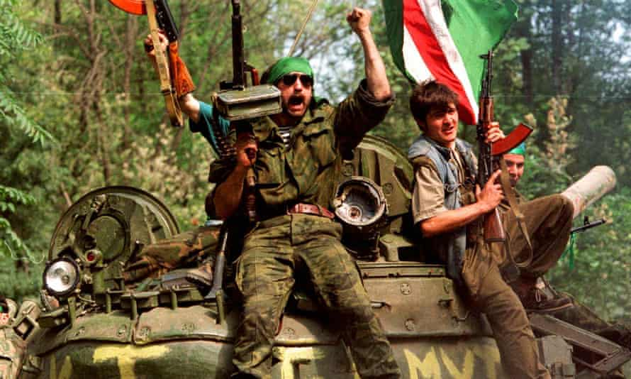 Chechen separatist fighters brandish weapons in Grozny in 1996.