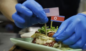Miniature American and North Korean flags are used to decorate the 'El Gringo and El Hombre Cohete' tacos