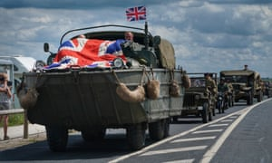 Vintage army vehicles head to head into Arromanches in Normandy