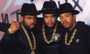 Run DMC in their signature hats, gold chains and chunky glasses.