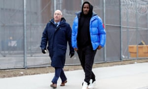 R Kelly, right, leaves Cook County jail, Chicago, with his attorney, Steve Greenberg.
