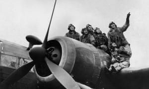 A group of Polish pilots balance on the wing of a Wellington bomber at an RAF base in December 1940