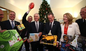 Greens leader Richard Di Natalie photo bombs the picture opportunity with speaker Tony Smith, Malcolm Turnbull, and Bill Shorten.
