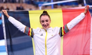 Gold medallist Nina Derwael celebrates winning the gold medal.