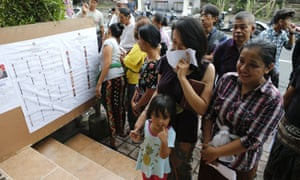 People queue up before the start of voting during presidential and legislative elections in Bali, Indonesia