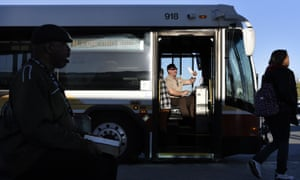 Bus driver Victor Caires of County Connection waits for customers on his free shuttle bus at the Pittsburg/Bay Point BART station Thursday, March 17, 2016, in Pittsburg, Calif. Bay Area commuters faced overcrowded trains, travel delays and other inconveniences for the second time in two weeks on Thursday due to a mysterious electrical problem affecting the region's rail transit system. Bay Area Rapid Transit officials said 50 of their train cars, twice as many as originally estimated were damaged by unexplained power surges on Wednesday. (Michael Short/San Francisco Chronicle via AP)